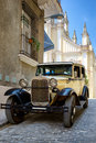 Classic car in a cobblestone street in Old Havana Royalty Free Stock Photo