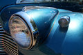 Classic car detail silver colored showing radiator bonnet headlight and sidelight and mudguard Royalty Free Stock Image