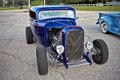 Classic car hotrod front of parked blue Royalty Free Stock Photos