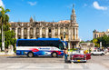 Classic car and tourism bus in Havana Royalty Free Stock Photos