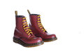 Classic cherry red oxblood doc martens lace up boots new york oct a pair of eyelet inch unisex fashion combat with yellow laces Royalty Free Stock Images