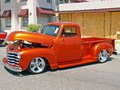 Classic chevrolet truck this is a copper colored customized with a lowered suspension and after market wheels Royalty Free Stock Image
