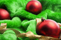 Classic Christmas ornament on green fabric Royalty Free Stock Photography