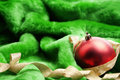 Classic Christmas ornament on green fabric Royalty Free Stock Images