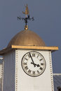 Classic clock tower with weather vane Royalty Free Stock Photo