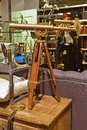 Classic design telescope with wooden leg support in a shop selling vintage goods