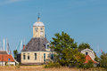 Classic Dutch wooden church and houses in Durgerdam Royalty Free Stock Photo