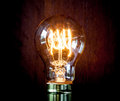 Classic edison light bulb with looping carbon filament a Stock Photography
