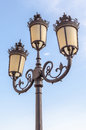 The classic elegant street lampposts with blue sky background. Royalty Free Stock Photo