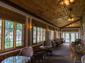Classic enclosed porch at old historic hotel used as a game or library room in an Stock Photos