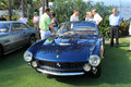 Classic ferrari lusso front view quarter of s t high end sports car surrounded by people at cavallino concorso d eleganza at the Stock Photos