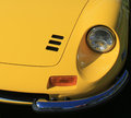Classic ferrari sports car headlamp and vent headlamps hood vents fender bumper yellow dino gt by pininfarina cavallino concorso Royalty Free Stock Photography