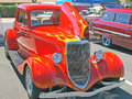 Classic ford three window coupe this is a with a spectacular red paint job which includes flame accents Stock Images