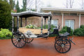 Classic funeral carriage with coffin and flowers Royalty Free Stock Photos