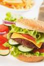 Classic hamburger with cheese, tomato and lettuce Stock Photos
