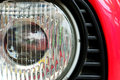 Classic headlamp of vehicle old red with the scratch Royalty Free Stock Photography