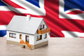 Classic house against british flag background Stock Photography