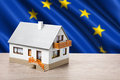 Classic house against eu flag background Royalty Free Stock Image