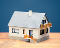 Classic house model blue background Royalty Free Stock Photography