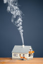 Classic house smoke trail blue background Royalty Free Stock Image