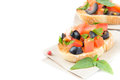 Classic italian appetizer bruschetta with tomato basil and blac black olives as a background Royalty Free Stock Photography