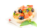 Classic italian appetizer bruschetta with tomato basil and blac black olives for your text Royalty Free Stock Images