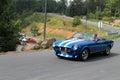 Classic italian sports car on road Royalty Free Stock Photo