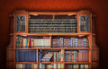 Classic library antique furniture and books Royalty Free Stock Images