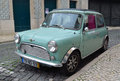 Classic light blue austin mini motorcar lisbon portugal march in the streets of the alfama district of lisbon portugal Stock Photo