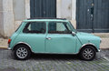 Classic light blue austin mini motorcar lisbon portugal march in the streets of the alfama district of lisbon portugal Royalty Free Stock Photos