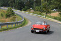 Classic little red italian sports car on downhill road Royalty Free Stock Photo