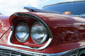 Classic luxury american car headlamp detail and ornamentation close up chrysler new yorker shallow depth of field sky and clouds Royalty Free Stock Photos