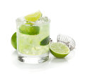 Classic margarita cocktail with lime and salty rim isolated on white background Royalty Free Stock Photos