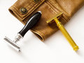 Classic men s razors placed on leather jacket a gold razor and a black and silver razor brown sleeve image could be used as an Royalty Free Stock Photos
