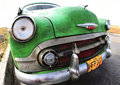 Classic old car is green color Royalty Free Stock Photo