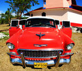 A classic old car is red color Royalty Free Stock Photo