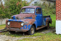 Classic old ford pickup rusty blue truck front view Stock Photography