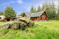 Classic old log cabin house in the country side. Royalty Free Stock Photo