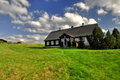 Classic old wooden cottage a in the mountains and meadow jizerske hory czech republic Stock Photography