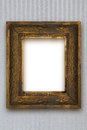 Classic old wooden picture frame carved by hand on gray wallpaper Royalty Free Stock Photo