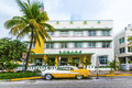 Classic oldsmobile with chrome radiator grill parksd in front of miami beach fl july parks the restaurant and hotel avalon miami Royalty Free Stock Image
