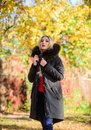 Classic parka coat has become wardrobe icon. Versatile functional and stylish. Girl wear parka while walk park. Youth
