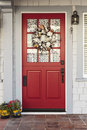 Classic red door to a white home Royalty Free Stock Photo