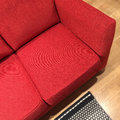Classic red sofa on wooden floor Royalty Free Stock Photo