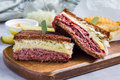 Classic reuben sandwich, served with dill pickle, potato chips, horizontal Royalty Free Stock Photo