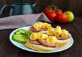 Classic sandwich with sausage and cheese on white baguette. Breakfast. Royalty Free Stock Photo