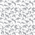 Classic seamless pattern. Tracery of twisted stalks with decorative leaves on a white background. Vintage style Royalty Free Stock Photo