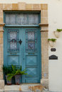 Classic style cyan wooden door house entrance and cat Royalty Free Stock Photo