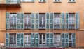 Classic style french balconies with big windows Royalty Free Stock Photo