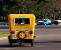 Classic three wheeled taxi in havana cuba yellow Royalty Free Stock Photography